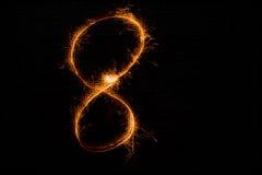 8 сделал бенгальских огней на черноте Стоковая Фотография