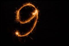 9 сделал бенгальских огней на черноте Стоковое фото RF