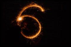 6 сделал бенгальских огней на черноте Стоковые Изображения RF