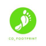 След ноги углерода концепции выходит значок в зеленый круг Стоковое фото RF