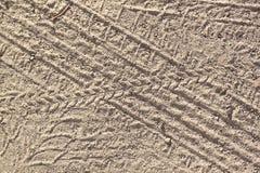 Следы автошины в песке Стоковая Фотография