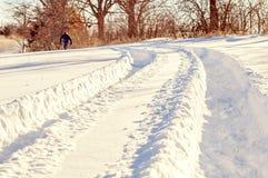 Следы автошины трактора в глубоком снеге Стоковая Фотография