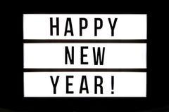 С Новым Годом!! текст в светлой коробке стоковая фотография rf