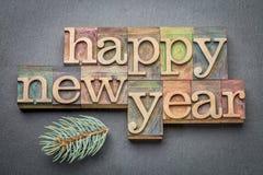 С новым годом в деревянном типе Стоковые Фото