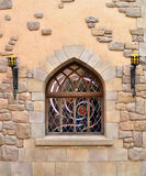 Сдобренное окно в каменной стене Стоковые Фото
