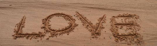 Слова влюбленности на песке Стоковая Фотография RF