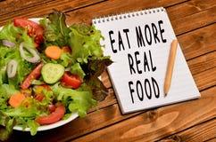 Слова едят более реальную еду стоковые изображения rf