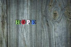 Слова надежды от малых пестротканых деревянных писем Стоковая Фотография RF