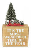 Слова приветственного восклицания рождества с деревом и колоколами Стоковое фото RF