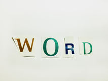 Слово - вырез формулирует коллаж смешанных писем кассеты с белой предпосылкой стоковые изображения rf