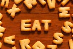 Слово ест написанный с шутихой Стоковые Изображения RF