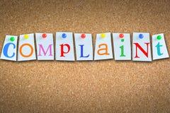 Слово жалобы предлагая работу с клиентом на панели пробочки Стоковое Фото
