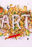Слово ИСКУССТВА на предпосылке покрашенных shavings карандаша Стоковая Фотография