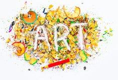 Слово искусства на предпосылке ярких покрашенных shavings карандаша Стоковые Фотографии RF