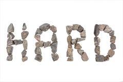 Слово крепко сделанное с малыми утесами Стоковая Фотография RF