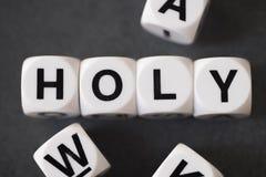 Слово святое на кубах игрушки стоковые фотографии rf