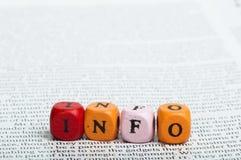 Слово info. Деревянные кубики на кассете стоковое фото rf