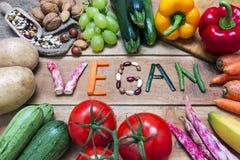 слово vegan на деревянной предпосылке Стоковое фото RF