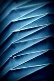 Сложенная бумажная форма в голубом цвете стоковые изображения