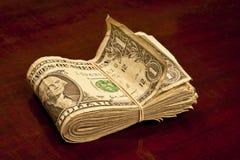 Сложенная валюшка используемых долларовых банкнот стоковые фотографии rf