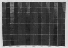 Сложенная черная бумага в 128 частях с белой предпосылкой Стоковое Изображение