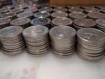 Сложенные вверх монетки песо Стоковая Фотография