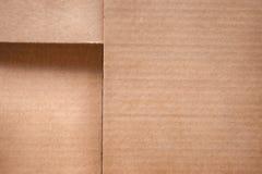 Сложенный конец крышки картонной коробки вверх Текстура и предпосылка Стоковые Фотографии RF