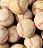 Сложите вверх стог старого бейсбола в зеленом цвете Стоковое Фото