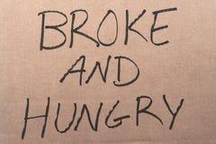 Сломал и голодный знак картона Стоковая Фотография
