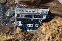 Сломленная клавиатура в воде Стоковые Фотографии RF