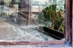 сломленное окно Стоковые Изображения