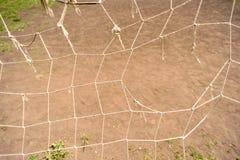 Сломленные спорт ловя сетью цель футбола Стоковые Фото
