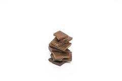 Сломленные части шоколада изолировано Стоковые Изображения RF