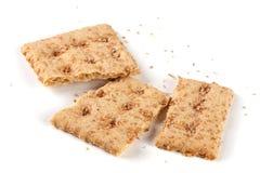 Сломленные crispbreads зерна изолированные на белой предпосылке Стоковая Фотография