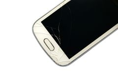 Сломленный умный телефон изолированный на белизне Стоковое фото RF