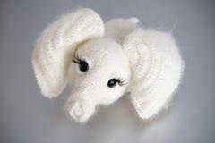 Слон игрушки на серой предпосылке Стоковая Фотография