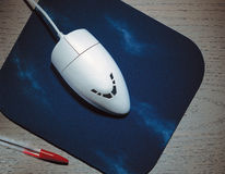 Слон мышь компьютера на циновке мыши Стоковое Фото