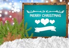 С Рождеством Христовым на голубом классн классном с сосной и снегом города blurr Стоковое Фото