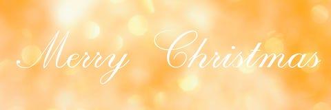 С Рождеством Христовым, помечающ буквами на золотой запачканной предпосылке стоковые изображения rf