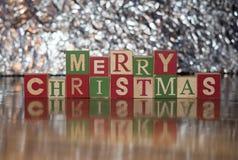 С Рождеством Христовым против серебра Стоковая Фотография