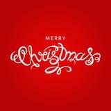 С Рождеством Христовым литерность руки на красной предпосылке Стоковые Изображения