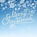 С Рождеством Христовым литерность руки на предпосылке с снежинками Стоковое Изображение