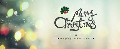 С Рождеством Христовым и счастливый текст Нового Года на предпосылке bokeh Стоковое Изображение RF