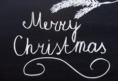 С Рождеством Христовым написанное на классн классном Стоковое фото RF