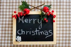 С Рождеством Христовым написанное на классн классном Стоковые Изображения RF