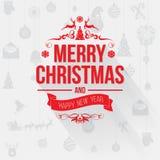 С Рождеством Христовым поздравительная открытка с красными письмами на свете - серой предпосылке Стоковые Изображения RF