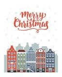 С Рождеством Христовым поздравительная открытка с домами Амстердама зимы Стоковая Фотография