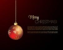 С Рождеством Христовым рождественская открытка с красной безделушкой Стоковое Изображение
