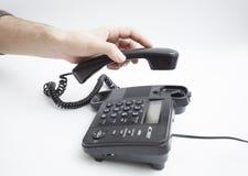 С рукой телефонной трубки Стоковое Фото