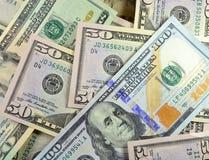 Случайная куча денег с новые $100 Стоковая Фотография RF